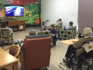 Elderly residents watching movie together